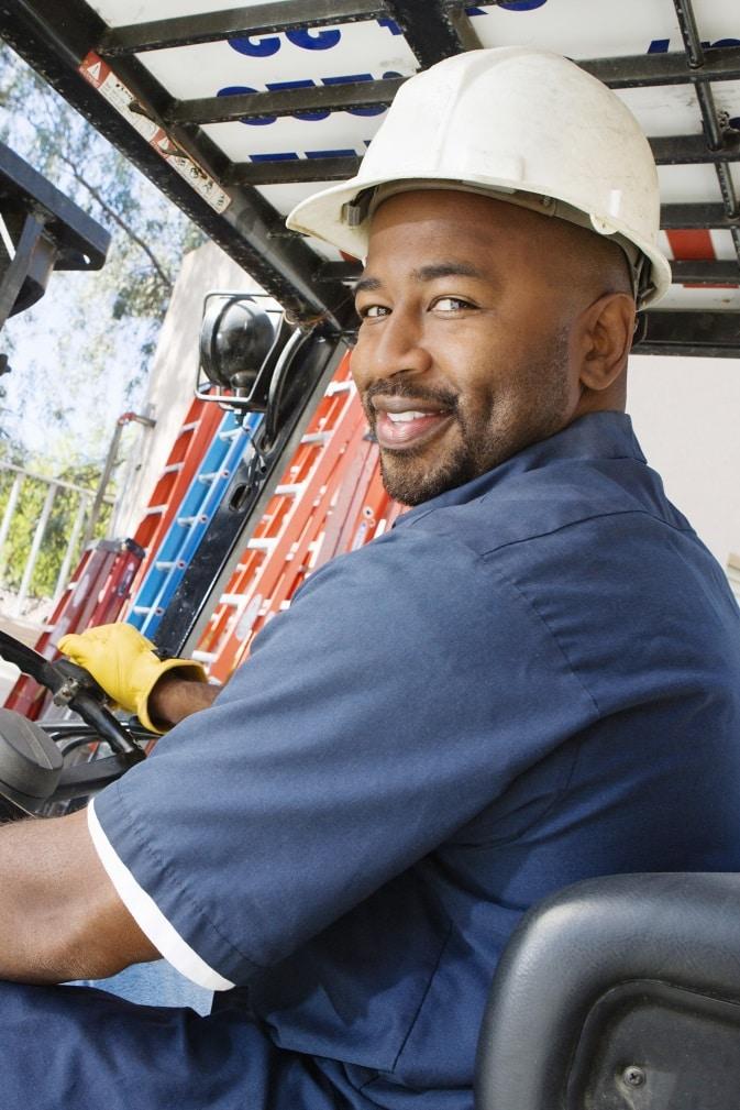 Man steering forklift truck